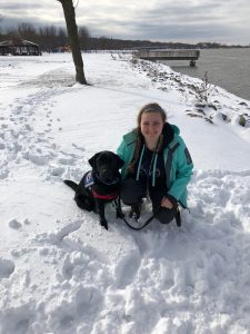 service dog in training with puppy raiser from Augustana College's Viking Pups club